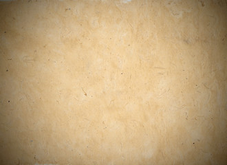 Grungy poster board, raw mock up, visible fibers, with vignette. Neutral authentic background surface, ocher tone. Template for your design.