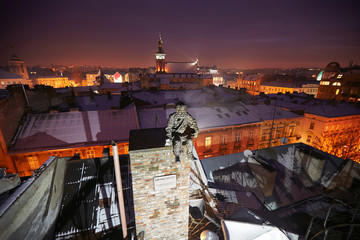 Statue of chimney sweep winter night
