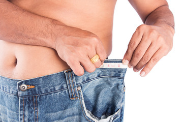 Man abdomen with measuring tape