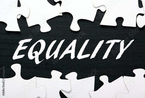 """The word Equality in white text on a blackboard with a ..."