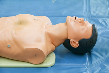 medical dummy on CPR, in emergency refresher training to assist