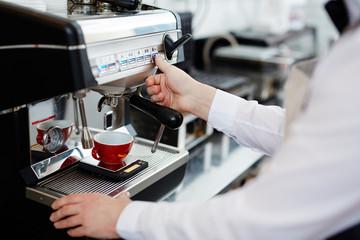 Preparing hot coffee