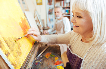 Female artist spending time in painting class