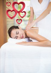Masseur giving massage to woman at spa