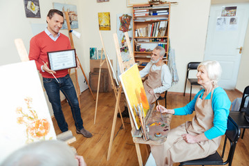 Handsome man demonstrating a painters diploma