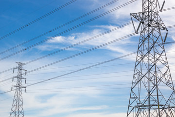 high voltage electric pole with blue sky and cloud