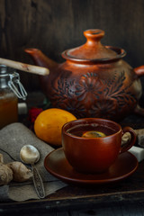 Nice and hot ginger tea with lime and lemon.