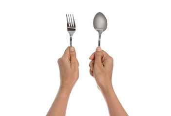 A knife and fork being held by woman's hands. Isolated