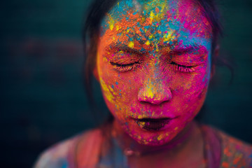 Fluorescent face painting on a woman