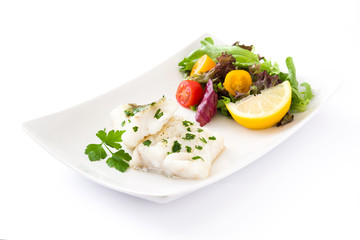 Fried cod fillet and salad in plate isolated on white background
