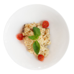 Creamy risotto in porcelain plate isolated on white