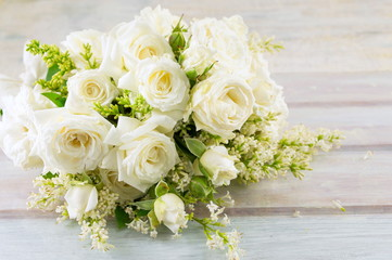 bouquet of white roses on a table
