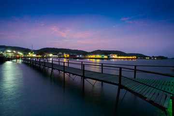 Walk way to pier at night time of colorful resort at pattaya thailand
