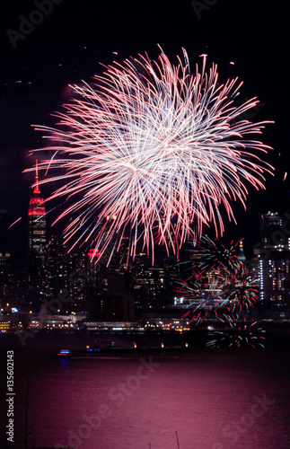 celebrate chinese new year fireworks in hudson river new york with empire state building as background