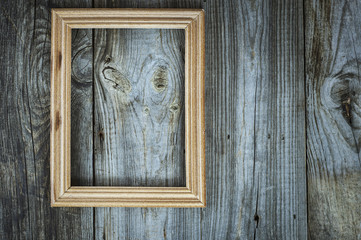 empty wooden frame on aged gray wooden wall
