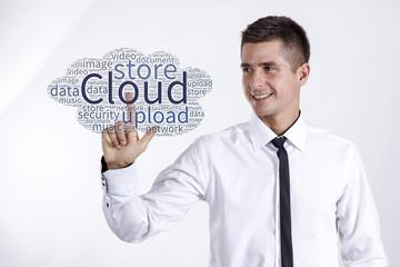 Virtual Cloud - Young businessman touching word cloud