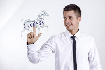 Success - Young businessman touching word cloud