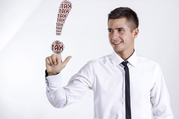 TAX - Young businessman touching word cloud