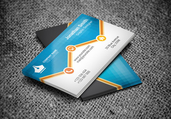 Business Card Layout with Orange Zigzag Element