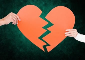 Close up of couple hands holding broken heart