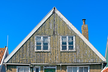 Detail of a house worn out facade in Marken