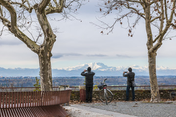 Men photographing Monte Rosa, Italy Alps