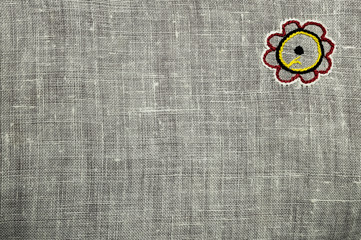 White canvas texture with sewed flower, background