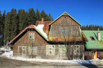 old wooden cottage in Beskydy mountains, Czech Republic on sunny winter day