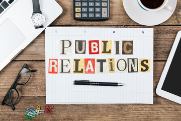 Public Relations in newspaper letters on note pad