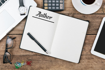 Author in note pad;