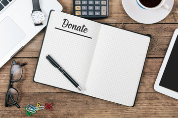 Donate written in note pad