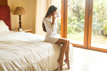 young girl in white robe in hotel