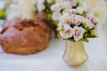 pink roses in a gold vase