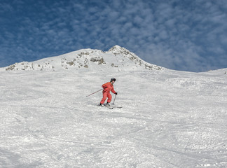 The young woman on a mountain-skiing slope of the resort of Mayrhofen - Austria