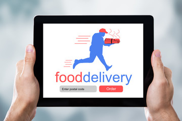 Digital Tablet Showing Food Delivery Application On A Screen