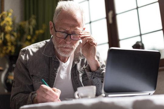 Businessman working at home, hard light effect