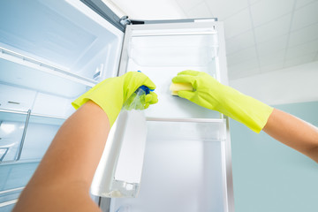 Woman Hand Cleaning The Empty Refrigerator