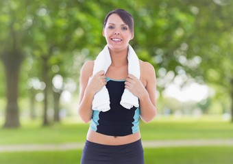 Portrait of fit woman holding towel around her neck