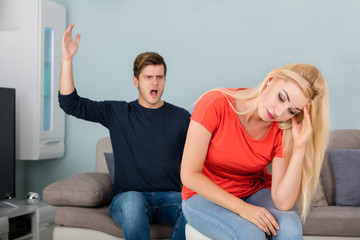 Man Shouting To His Wife At Home