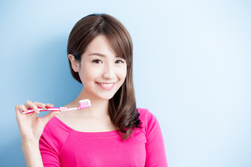 beauty woman brush her teeth