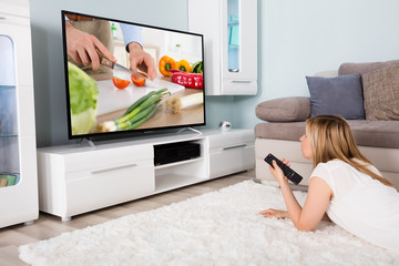 Woman Watching Cooking Show On Television