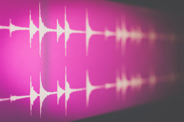 digital waveform on screen, music background. recording concept