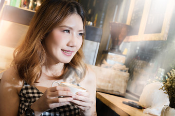 asain beauty girl happy in checker dress smiling with hot cofee