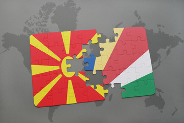 puzzle with the national flag of macedonia and seychelles on a world map
