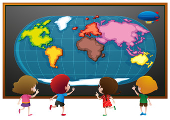 Children looking at worldmap poster
