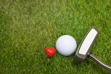 golf ball with love heart shape on green grass