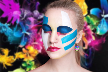 Creative girl model pink blue white colors. Bright conceptual art make-up glows light party time. Multicolored pins, clamps, clips dark hair. Artistic shiny good lifestyle. Dreamy emotion
