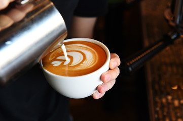 cup of latte art coffee for background