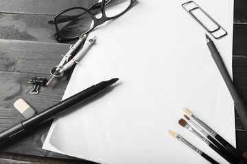 Blank notebook and pencil with glasses on wooden table