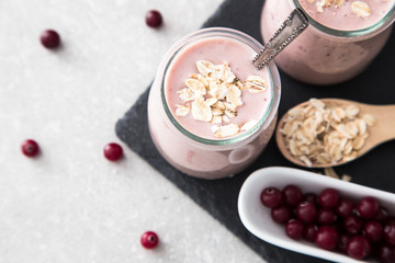 Smoothie of banana and cranberries with yogurt and oats